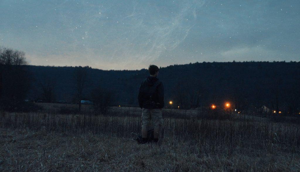 boy outside as it gets dark
