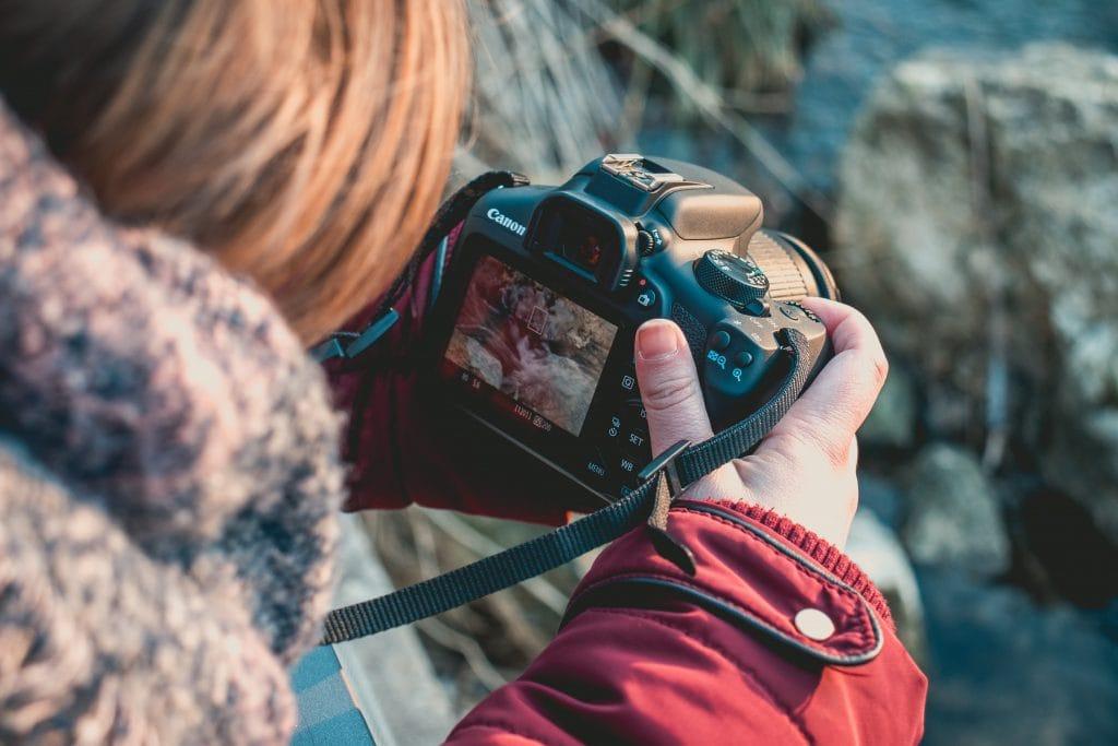 child using camera to take photos of natue