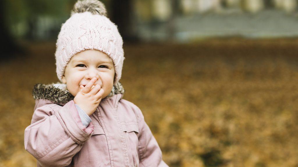 happy girl eating snack outside