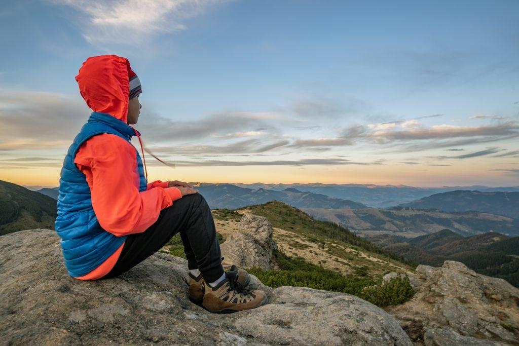 child on hike taking break and enjoying view