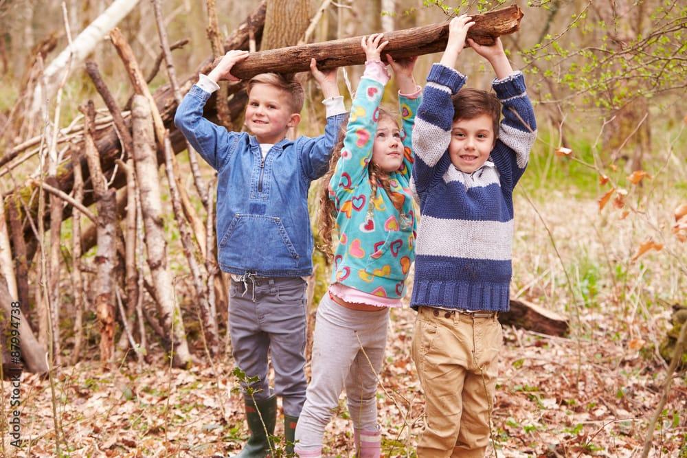children building a den, shelter, lean-to using sticks